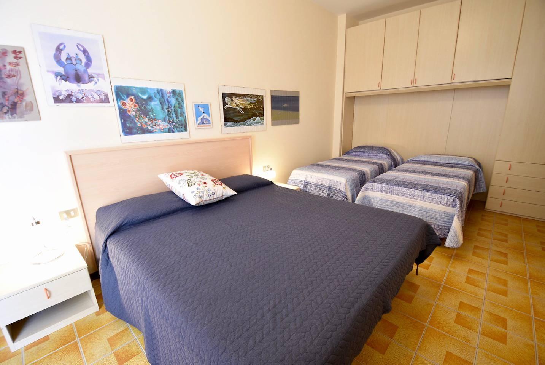 camera-da-letto-appartamento-1804707478.jpeg